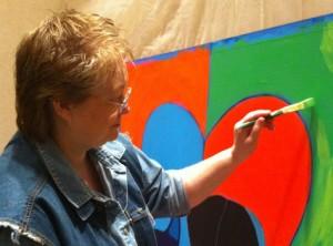 Artist BZTAT painting process on location